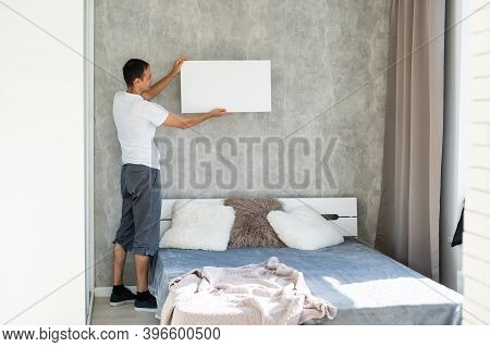 Man With Canvas Mockup. Photo Mockup. The Man Hold Canvas. For Canvas Design.