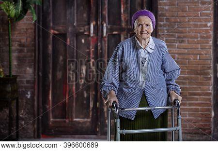 Portrait Of  Caucasian Senior Woman With Walker Indoors