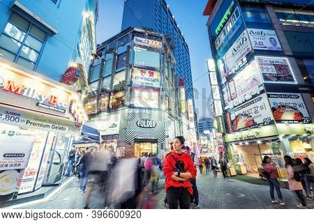 Seoul, Soth Korea, 29 March 2018 : Korean People And Tourist Walking Around Myeong-dong  At Night Fo