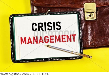 Crisis Management. Text Label In The Planning Notebook On The Manager's Briefcase . The Process Of A