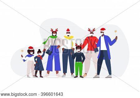 African American Multi Generation Family In Santa Hats Wearing Masks To Prevent Coronavirus Pandemic