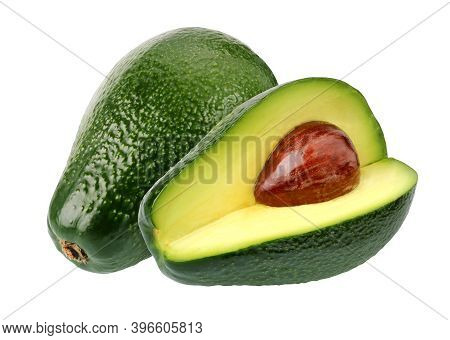 Avocados Isolated On White Background. Whole And Half Green Pear-shaped Fruits. Alligator Pear.
