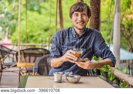 Caucasian Man And Traditional Drip Brewed Vietnamese Coffee From A Phin Filter