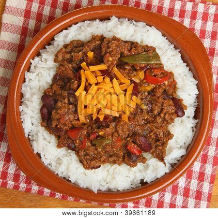 Chilli con carne with rice and grated cheese