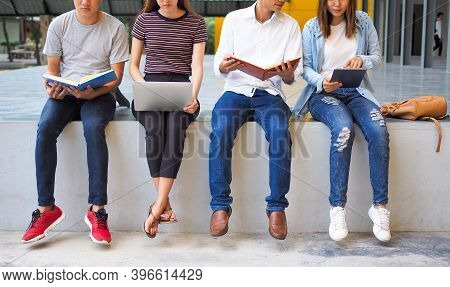 A Group Of Students Are Sitting On A Counsellor Doing Their Homework Or Reading A Book Preparing For
