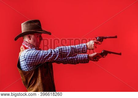 Man Wearing Cowboy Hat, Gun. Portrait Of A Cowboy. West, Guns. Portrait Of A Cowboy. Western Man Wit