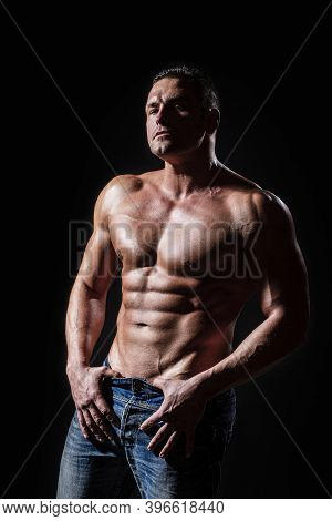 Muscular Sexy Man With Torso. Muscular Model Sports Young Man On Dark Background. Sensual Man With N