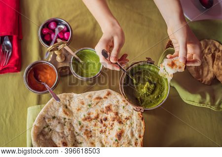 Caucasian Woman Eating Indian Food In Cafe. Traditional Indian Dish. Indian Food. Close-up