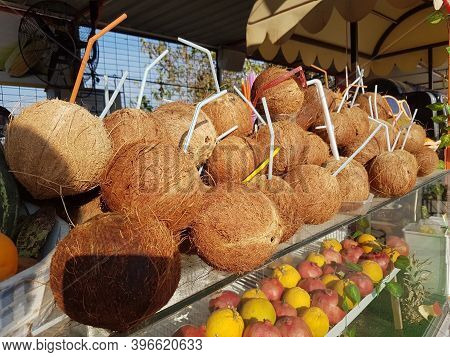 Drinking Coconuts Showcase. Hand Open The Group Coconut Use Knife And Give To Tourist For Drink.