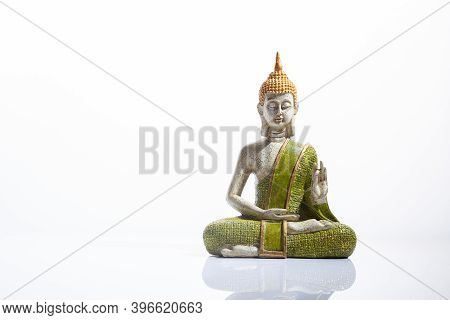 Green And Golden Buddha Statue, On White Background.  Meditation, Spirituality And Zen Concept.