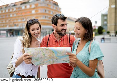 Happy Friends Enjoying Sightseeing Tour In The City.
