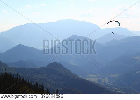 Wonderful Paragliding Moment: Paragliding Concept / Paraglider Flying In Beautiful Natural Mountain