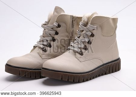 Beige Winter Boots With Thick Soles. Fashion Trends In The Shoe Industry Concept