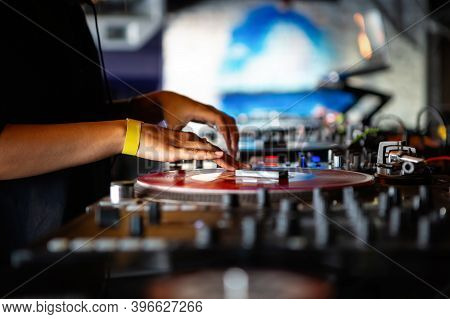Dj Girl Playing Music In Night Club With Retro Turntables & Vinyl Records.female Disc Jockey Scratch
