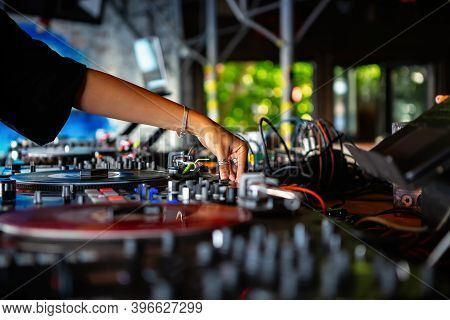 Female Dj Mixes Musical Tracks On Party In Bar.professional Disc Jockey Girl Playing Music On Hip Ho
