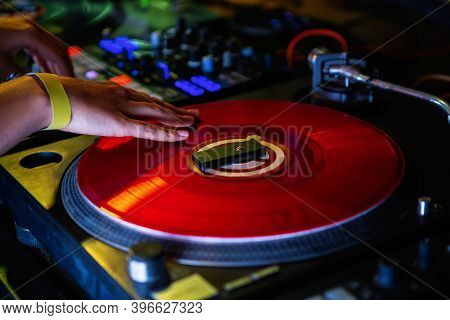 Dj Girl Scratches Vinyl Record With Music On Hip Hop Party In Nightclub.professional Female Disc Joc