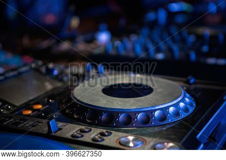 Dj Turntable On Stage In Night Club.professional Disc Cd Player Device For Playing Musical Tracks On