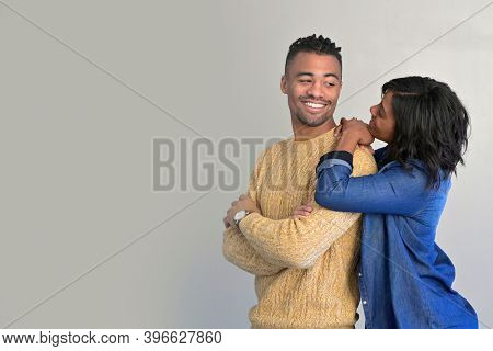 Portrait of african american couple standing together on background, isolated