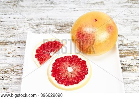 Grapefruit Isolated On White Plate. Freshly Harvested Grapefruit. Healthy Fruit Concept