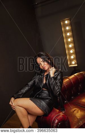 Sexy Unformal Brunette Woman In Leather Jacket Leather Skirt And Lace Bralette Posing Dark Leather S
