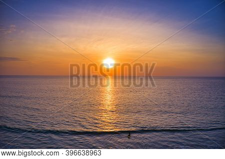 Aerial Drone View Beautiful Sunset Over The Clam Sea With Cloud And Sky Background. Sunset Over Trop
