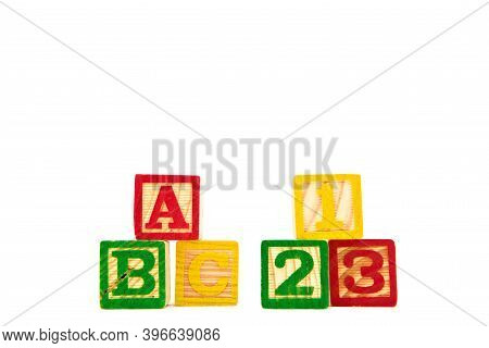 Colored Letter Cubes Made From Wood Spelling Abc And 123 To Illustrate The Concept Of Learning. Isol