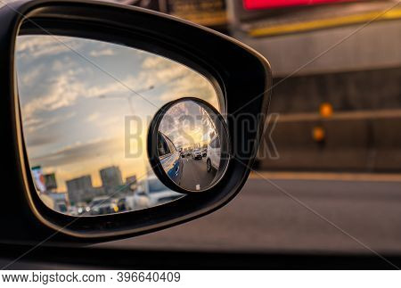 Reflection Of Traffic Flow On Asphalt Road In Side Mirror Of Blue Suv. Car Wing Mirror With Convex M