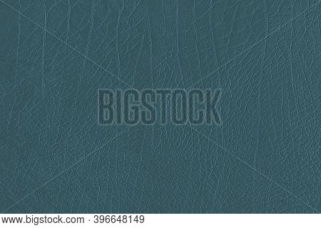 Blue creased leather textured background