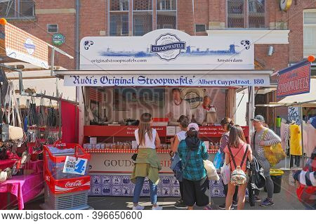 Amsterdam, Netherlands - May 15, 2018: People Waiting For Famous Stroopwafels At Street Market In Am