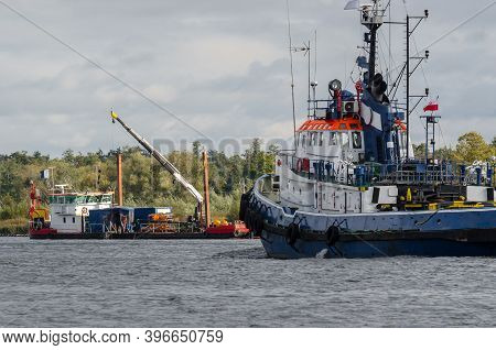 Tugboat And Self Propelled Working Barge - Hydrotechnical Works On The Waterway