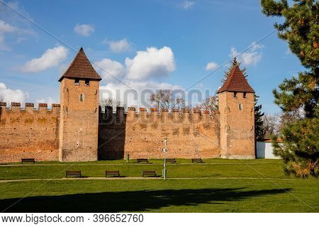 Silhuette Of Town Fortification With Battlement And Watch Tower In Sunny Autumn Day, Medieval Gothic