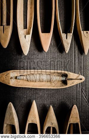 Spindle, Manual Spinning. Vintage Wooden Boat Shuttles For Hand Weaving. The Weft Yarn Is Unwound Fr