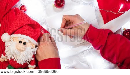 Write A Wish List For Santa With A Red Pen On A Blank White Sheet. Red Christmas Balls And A Handmad