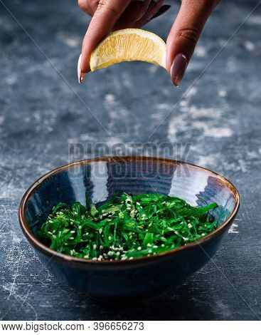 Chuka Laminaria Seaweed Salad With Lime On Plate. Traditional Japanese, Chinese, Korean Asian Seafoo