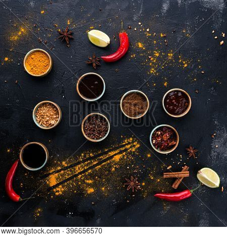 Set Of Sauces - Ketchup, Mustard Soy Sauce, Bbq Sauce, Chimichurri, Mustard Grains And Sauce On Dark