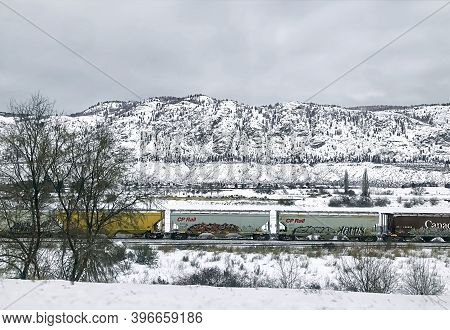Kamloops, Bc, Canada - January 15, 2020. Railroad In The Snowy Thompson River Valley. Freight Railro