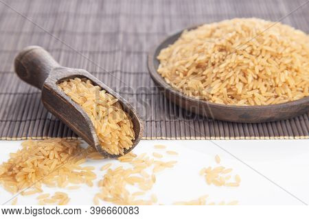 Close Up, Selective Focus, Brown Rice On Wooden Plate And Spoon.