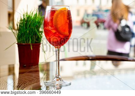 Traditional Spritz Aperitif In A Bar In Italy, Glass Of Cocktail Aperol Spritz On Table In A Terrace