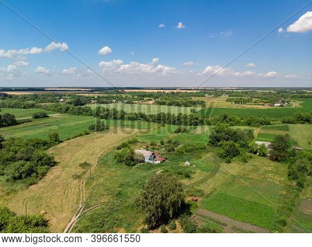 Top View Of Rural Houses Surrounded By Fields In Central Russia