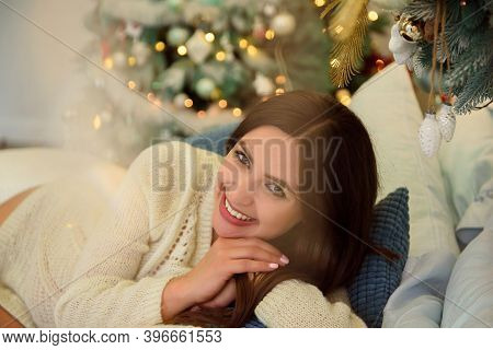 Pregnancy, Holidays, People And Expectation Concept - Happy Pregnant Woman Lies On Bed At Home Over