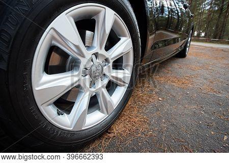 Grodno, Belarus - December 2019: Audi A6 4g C7 Luxury Car Closeup Alloy Wheel With Dunlop Winter Tir