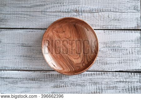 Empty Wooden Plate Of Elm On Wooden Background