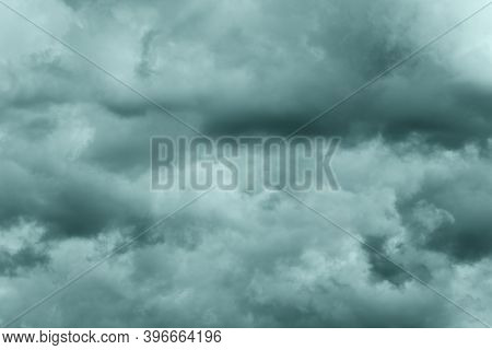 Dramatic Storm Clouds In Rainy Weather In Sky, Coloring In Trend Tidewater Green Color Of Year 2021.
