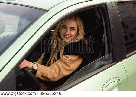 Beautiful Happy Girl On Car Window, Young Woman Driving Her Car.