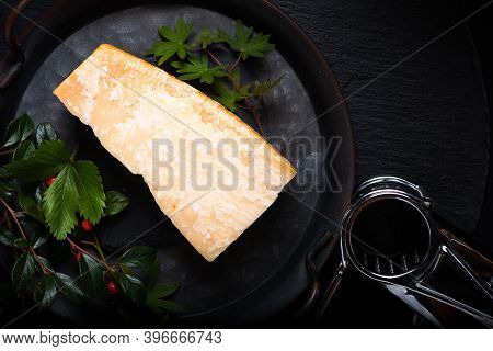 Food Concept Organic Parmesan Cheese In Rustic Iron Tray On Black Slate Stone Background With Copy S