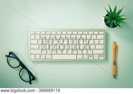 White Portable Computer Keyboard Keys Or Keyboard Button And Office Supply Including Orange Pen And