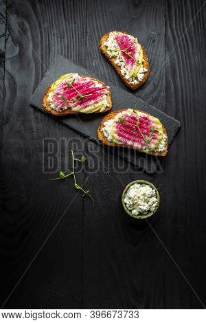 Healthy Breakfast Toasts From Sliced Watermelon Radish Or Chinese Daikon With Goat Cheese, Microgree