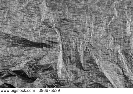 Background With Silver Crumpled Sheet Of Paper With Vignetting