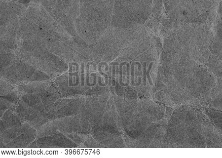 Background With Gray Crumpled Sheet Of Fabric With Vignetting