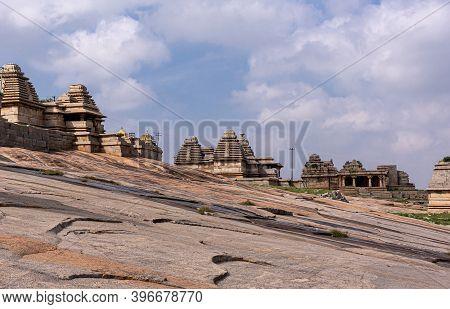 Hampi, Karnataka, India - November 4, 2013: Virupaksha Temple Complex. Brown Stone Defensive Walls A